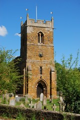 Typical English village church with tower in Rushton