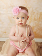 Baby with pearl necklace