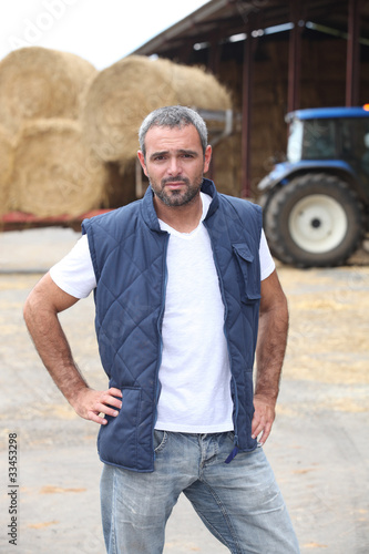 Farmer stood in front of tractor