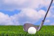 Golf iron behind ball