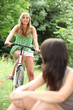 Teenagers riding bikes