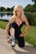 Woman fastening her roller skates
