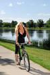 Woman bicycling at the lake