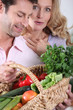 Wife surprised by vegetable basket.