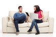 young couple relaxing with laptop book