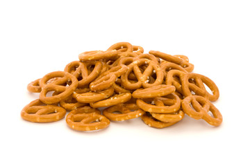 Pile of salted pretzels on white