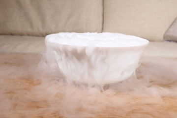 smoke of dry ice on table