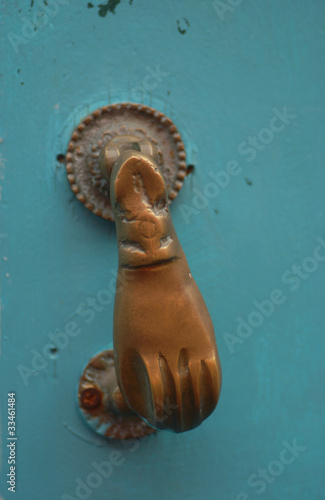 handler of metal on blue wooden door in canary island