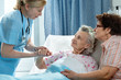 Senior patient is being visited by the daughter in hospital