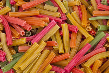 Colored pasta pieces as seen on street market of Agra, India.