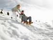 Young Couple Sledding