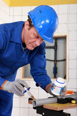 Skilled technician repairing canalizations
