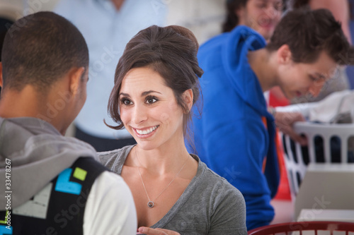 Smiling Woman In Laundromat
