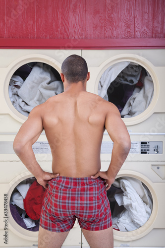 Muscular Man In Laundromat