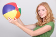 Teenage girl holding inflatable beach ball
