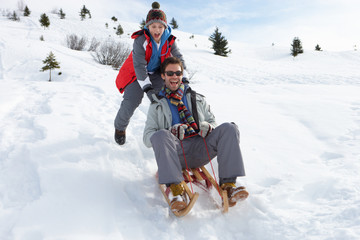 Young Father And Son Sledding