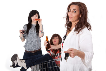Sober mother taking car keys away from drunk party girls