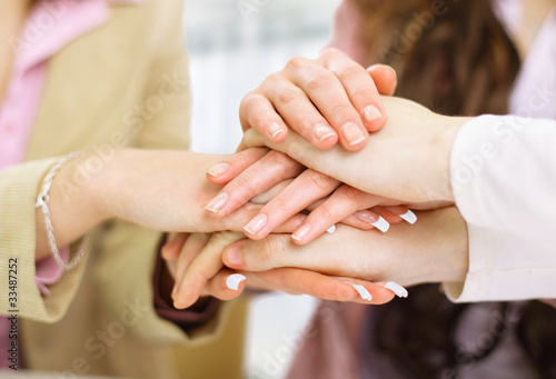Image of business partners hands on top of each other