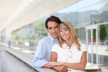 Portrait of handsome couple standing outside
