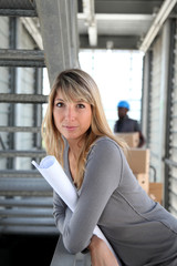 Businesswoman standing in warehouse