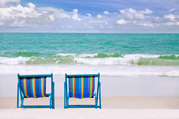 lounge chairs at a coastline