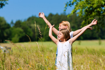 Happy children in a meadow