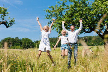 Happy family outdoors jumping