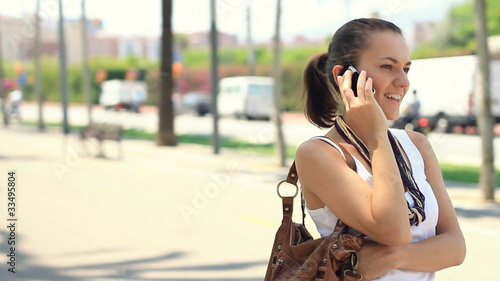 Beautiful woman talking on the phone, steadicam shot