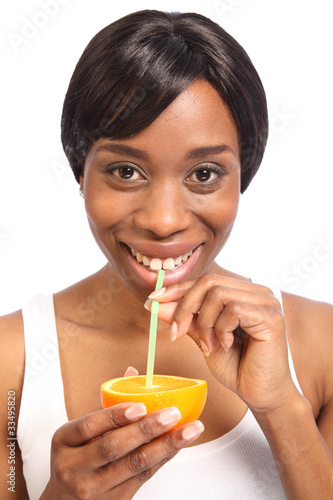 Healthy fresh orange drink for beautiful woman