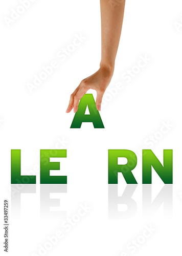 Hand holding letter A of word Learn