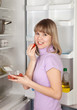 woman taking  Cherry-tomatoes    from fridge
