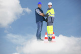 Photo-montage of building workers standing on a cloud