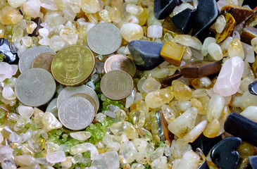 NT dollar coins and precious stones