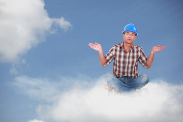 Montage of a handyman sitting on a cloud