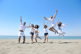 Fototapety happy young  people group have fun on beach