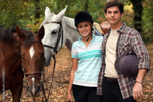 Horseback riders with their horses