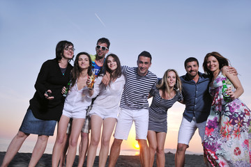 Group of young people enjoy summer  party at the beach