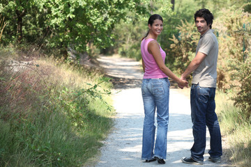Couple outdoors walking hand in hand