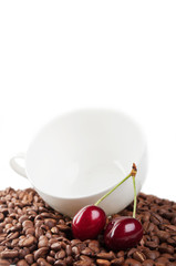 cup with coffee beans and cherry