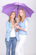 Girls under a purple umbrella