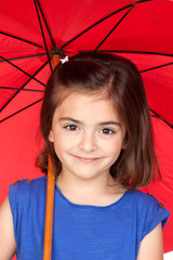 Brunette little girl with a red umbrella