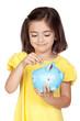Brunette little girl with a blue moneybox