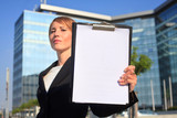 businesswoman holding a blank document