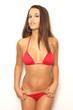 Pretty young brunette woman in red bikini