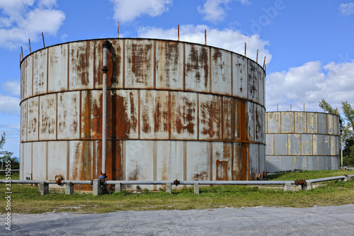 Old rusty oil tanks in Governor's Harbour - 33515255