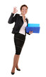 business woman with reports and ok gesture