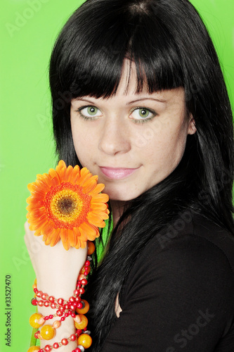 woman holds gerbera
