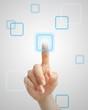 Hand pressing virtual button on futuristic holographic screen