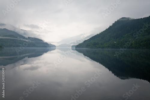 mist over the water and mountains