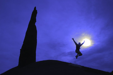 Hiker jumping for joy.